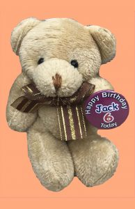 teddy bear with a badge